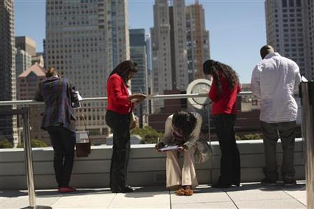 Job seekers apply for the 300 available positions at a new Target retail store in San Francisco, California August 9, 2012. REUTERS/Robert Galbraith