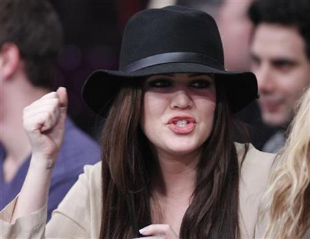 Actress Khloe Kardashian watches the Los Angeles Lakers play the Sacramento Kings during their NBA basketball game in Los Angeles, California, January 28, 2011. REUTERS/Lucy Nicholson/Files