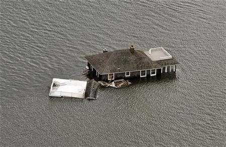 A house floats in the bay after it was washed from its foundation during Hurricane Sandy in Manotoloking, New Jersey October 31, 2012. REUTERS/Steve Nesius