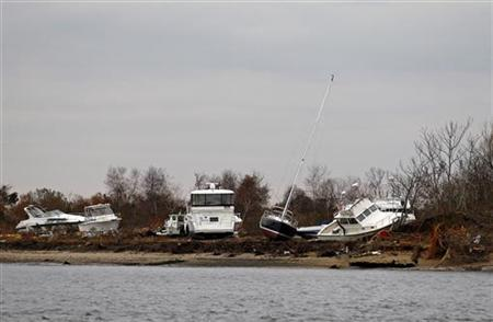 Boats damaged during Hurricane Sandy are seen on an island off Sea Bright, New Jersey, November 1, 2012. REUTERS/Adam Hunger