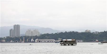 A wooden house belonging to a migrant family from the Philippines sits in the middle of the sea outside Kota Kinabalu September 17, 2012. REUTERS/Bazuki Muhammad