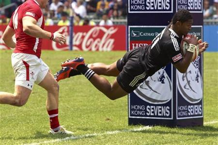 New Zealand's Waisake Naholo (R) dives to score a try against Wales during their quarter-final match at the Hong Kong Sevens rugby tournament in Hong Kong March 25, 2012. REUTERS/Garrige Ho/Files