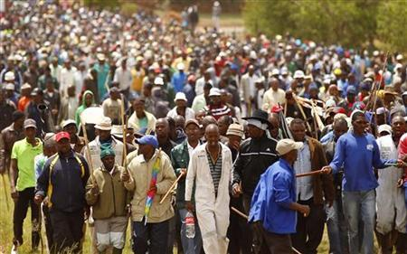 File photo of striking miners chanting slogans as they gather at the AngloGold Ashanti mine in Carletonville, northwest of Johannesburg October 24, 2012. REUTERS/Siphiwe Sibeko