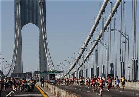 File photo of runners crossing the Verrazano bridge as they compete in the 2011 New York City Marathon in New York, November 6, 2011. REUTERS/Jessica Rinaldi/Files.