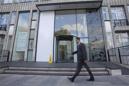 A man walks past the office building that houses Bumi Plc in London September 25, 2012. REUTERS/Neil Hall