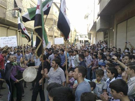 Demonstrators protest against Syria's President Bashar al-Assad after Friday prayers in Erbeen, near Damascus October 5, 2012. REUTERS/Shaam News Network/Handout