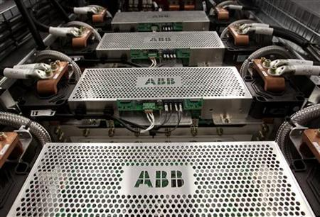 The company's logo is seen on protection grids of a traction transformer at a plant of Swiss engeneering group ABB in the town of Turgi west of Zurich June 9, 2010. REUTERS/Arnd Wiegmann