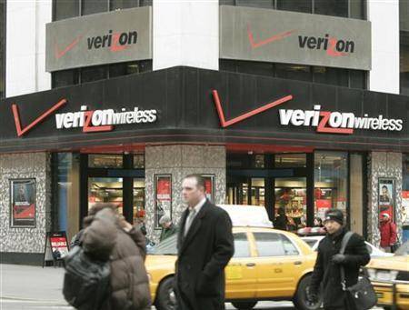 Traffic passes Verizon Communications Inc. headquarters in New York, February 14, 2005.