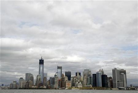 Lower Manhattan is seen from New York Harbor October 31, 2012. Few days after Sandy delivered a record blow, New York Harbor, the delivery point for the world's most actively traded gasoline and heating oil futures contracts, and a vital fuel source for the surrounding urban milieu, remained shut to commercial traffic, with no estimates for reopening. REUTERS/Brendan McDermid