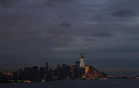 A general view of New York's Lower Manhattan with parts of it remaining in the dark and a lit-up One World Trade Center as seen from Weehawken, New Jersey, November 1, 2012. REUTERS/Gary Hershorn