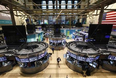 Traders work on the floor of the New York Stock Exchange following its reopening, October 31, 2012. U.S. stocks edged higher on Wednesday in the first trading session since a massive storm in the U.S. Northeast forced a two-day market closure. At least 30 people were killed and millions have been left without power after Hurricane Sandy slammed into the East Coast on Monday. The storm shut down most businesses in Manhattan and caused a rare flooding of the subway tunnels, which is expected to keep the system closed for several days. REUTERS/Brendan McDermid (UNITED STATES - Tags: DISASTER ENVIRONMENT)