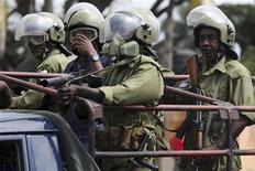 Riot policemen stand on a truck during as they patrol Zanzibar October 19, 2012. REUTERS/Goran Tomasevic