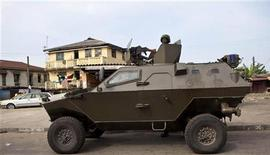 A Nigerian army Armored Personnel Carrier patrols in Lagos, Nigeria, April 26, 2011. REUTERS/Joseph Penney