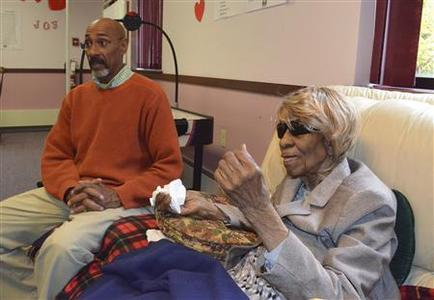 Betty Lockett, 103 and her second cousin Peter Smith, 64, who helped her get a voter ID are shown in Munster, Indiana October 18, 2012. Lockett moved from Illinois to Indiana this and wanted to vote but state officials would not accept her Illinois ID, asking for a passport or birth certificate. Democratic claims that a large number of Americans could be prevented from voting because of photo identification laws are probably overstated based on evidence from Georgia and Indiana, the two states where the laws have been in place for multiple elections, Reuters found. Photo taken October 18, 2012. REUTERS/Nick Carey