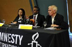 Officials of Amnesty international Lucy Freeman (L), Salil Shetty (C) and Steve Crawshaw speak during a news conference in Nigeria's capital Abuja November 1, 2012. REUTERS/Afolabi Sotunde