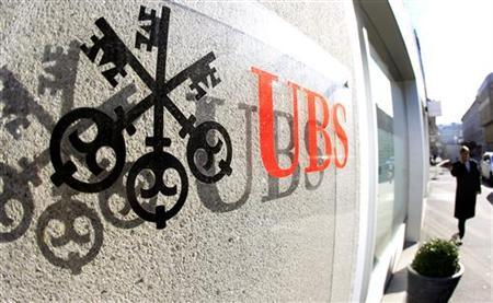 A logo of Swiss bank UBS is seen at an office building in Zurich October 30, 2012. Switzerland's biggest bank UBS unveiled plans to wind down its fixed income business and fire 10,000 bankers in one of the biggest bonfires of finance jobs since the implosion of Lehman Brothers in 2008. REUTERS/Arnd Wiegmann