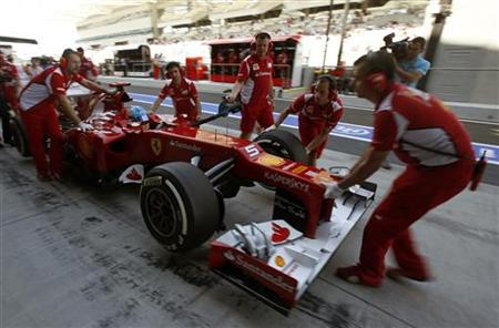Pit crew push the car of Ferrari Formula One driver Fernando Alonso of Spain during the first practice session of the Abu Dhabi F1 Grand Prix at the Yas Marina circuit on Yas Island November 2, 2012. REUTERS/Suhaib Salem