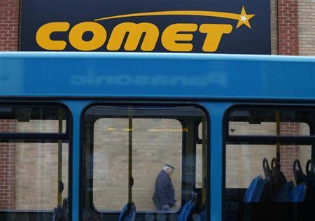 A shopper walks past a Comet store in Burton upon Trent, central England November 1, 2012. REUTERS/Darren Staples