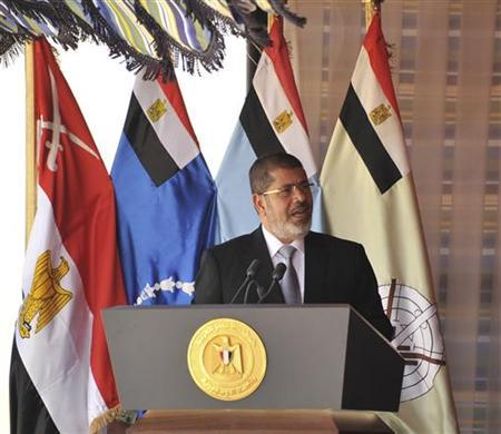 Egypt's President Mohamed Mursi speaks before watching a display of military maneuvers in the eastern Sinai, October 18, 2012. REUTERS/Egyptian Presidency/Handout