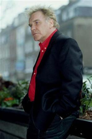 Comic Freddie Starr poses for pictures during a photo call to launch the new series Supply and Demand January 22.