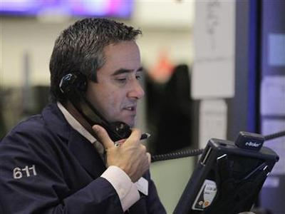 A trader works on the floor of the New York Stock Exchange following its reopening, October 31, 2012. REUTERS/Brendan McDermid