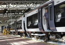 A worker stands in the doorway of a train at the Bombardier plant in Derby, central England, July 5, 2011. REUTERS/Darren Staples
