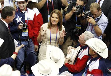 U.S. Rep. Michele Bachmann talks with members of the Texas delegation on the floor of the during the second session of the 2012 Republican National Convention in Tampa, Florida August 28, 2012. REUTERS/Joe Skipper