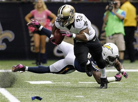 New Orleans Saints running back Darren Sproles (43) returns a kick during the second half of their NFL football game against the San Diego Chargers in New Orleans, Louisiana October 7, 2012. REUTERS/Jonathan Bachman