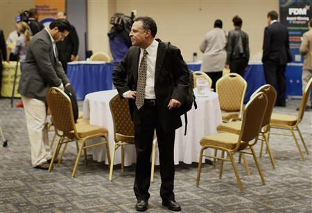 A job seeker looks around a room of prospective employers at a career fair in New York City, in this October 24, 2012 file photo. REUTERS/Mike Segar/Files