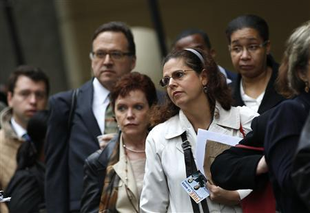 Job seekers stand in line to meet with prospective employers at a career fair in New York City, in this October 24, 2012 file photo. REUTERS/Mike Segar/Files