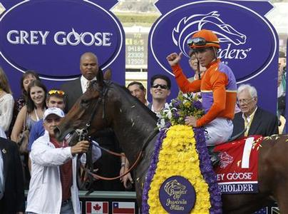 Jockey Garrett Gomez, atop Beholder, celebrates in the winner's circle after the running of the Breeders' Cup Grey Goose Juvenile Fillies thoroughbred horse race at Santa Anita Park in Arcadia, California, November 2, 2012. REUTERS/Danny Moloshok
