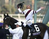 Mike Smith celebrates atop Royal Delta as he becomes the all-time winningest Breeders' Cup jockey after his victory in the running of the Breeders' Cup Ladies Classic thoroughbred horse race at Santa Anita Park in Arcadia, California, November 2, 2012. REUTERS/Danny Moloshok