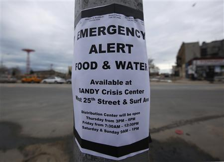 A sign posted on a lamppost alerts people to emergency food and water in Coney Island, New York, November 2, 2012. REUTERS/Brendan McDermid