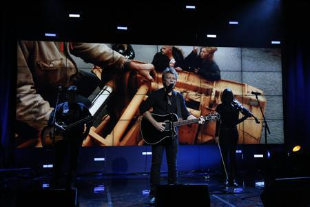 Musician Jon Bon Jovi performs during Hurricane Sandy: Coming Together, a Red Cross telethon on NBC to benefit victims of Hurricane Sandy, the storm that killed more than 100 and devastated parts of the U.S. Northeast, in New York, November 2, 2012. REUTERS/Heidi Gutman/NBC/Handout