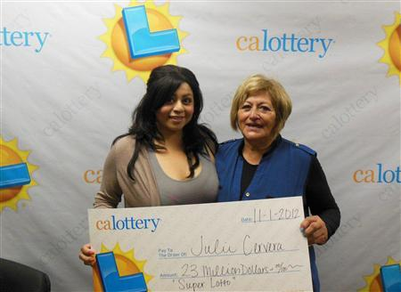 Charliena Borunda (L) poses with her mother, Julie Cervera (R) at a Calfornia Lottery news conference in San Bernardino, California November 2,2012 in this publicity photograph released by the California Lottery. REUTERS/Courtesy of California Lottery/Handout