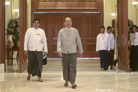 Myanmar's President Thein Sein walks out from his first news conference since his reappointment as head of the ruling party Union Solidarity and Development Party (USDP), at the presidential palace in Naypyitaw October 21, 2012. REUTERS/Soe Zeya Tun