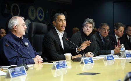 U.S. President Barack Obama (C) attends a briefing with FEMA administrator Craig Fugate (L) and cabinet secretaries about operations in the aftermath of Hurricane Sandy, at FEMA headquarters in Washington, November 3, 2012. Also pictured are (3rd L-R) Homeland Security Secretary Janet Napolitano, Defense Secretary Leon Panetta and Treasury Secretary Timothy Geithner. REUTERS/Jonathan Ernst