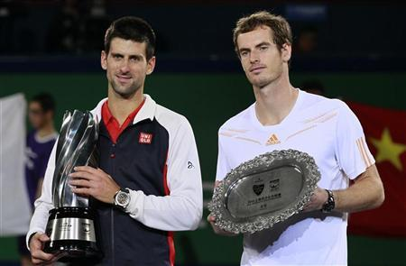 Novak Djokovic (L) of Serbia stands next to Andy Murray of Britain during the trophy presentation after their men's singles final at the Shanghai Masters tennis tournament October 14, 2012. REUTERS/Aly Song