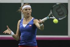 Czech Republic's Lucie Safarova returns a ball to Serbia's Ana Ivanovic during their final match of the Fed Cup tennis tournament in Prague November 3, 2012. REUTERS/David W Cerny