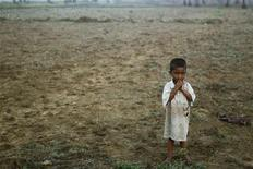 A boy, displaced by the recent violence in Pauktaw stands in the field near Owntaw refugee camp for Muslims outside Sittwe early November 1, 2012. U.N. human rights investigators called on Myanmar on Wednesday to halt deadly sectarian violence and warned it not to use the conflict as a pretext to remove Rohingya minority Muslims. Some 89 people have been killed in clashes between Buddhist Rakhines and Muslim Rohingyas in western Myanmar in the past 10 days, according to the latest official toll. REUTERS/Soe Zeya Tun