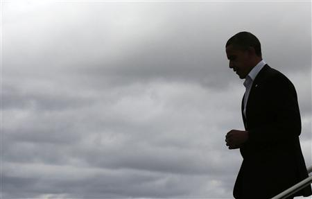 U.S. President Barack Obama walks down the steps of Air Force One after arriving at Cleveland Burke Lakefront Airport in Ohio, November 3, 2012. REUTERS/Larry Downing