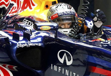 Red Bull Formula One driver Sebastian Vettel of Germany sits in his car during the qualifying session of the Abu Dhabi F1 Grand Prix at the Yas Marina circuit on Yas Island November 3, 2012. REUTERS/Suhaib Salem