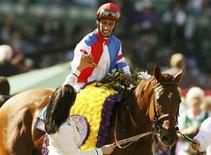 Horse Groupie Doll with Rajiv Maragh in the iron celebrates winning first place during the running of the Breeders' Cup Filly & Mare Sprint thoroughbred horse race at Santa Anita Park in Arcadia, California November 3, 2012. REUTERS/Danny Moloshok