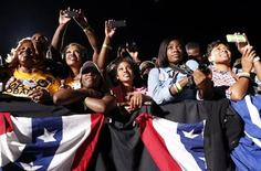 Women point their cameras at the stage as U.S. President Barack Obama speaks at a campaign rally in Cleveland, Ohio October 25, 2012. REUTERS/Kevin Lamarque