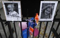 A makeshift memorial is left outside the Krim family apartment in New York, October 28, 2012. REUTERS/Carlo Allegri