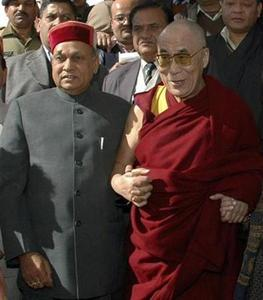 Tibetan spiritual leader, the Dalai Lama (R), poses with Prem Kumar Dhumal, chief minister of Himachal Pradesh, in Dharamsala December 17, 2008. REUTERS/Amit Kanwar/Files
