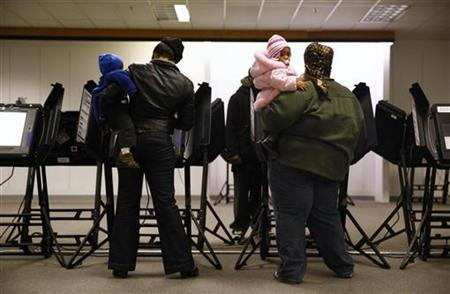 People take part in early voting in Columbus, Ohio October 30, 2012. REUTERS/Eric Thayer