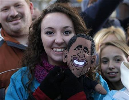 Student Tori Scranton holds a U.S. President Barack Obama doll at a campaign event at Washington Park in Dubuque, Iowa, November 3, 2012. REUTERS/Larry Downing