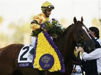 Jockey John Velazquez celebrates aboard horse Wise Dan after his first place win in the running of the Breeders' Cup Mile thoroughbred horse race at Santa Anita Park in Arcadia, California November 3, 2012. REUTERS/Danny Moloshok