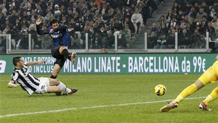 Inter Milan's Diego Milito (C) scores as Juventus' Leonardo Bonucci (L) and goalkeeper Gianluigi Buffon try to save during their Italian Serie A soccer match at the Juventus stadium in Turin November 3, 2012. REUTERS/Alessandro Garofalo/Files